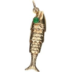 14 kt yellow gold pendant in the shape of a fish and set with emerald - length x width: 4.3 x 1 cm