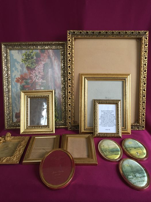 12 picture frames in various sizes, 1 is gilded and 1 gold plated