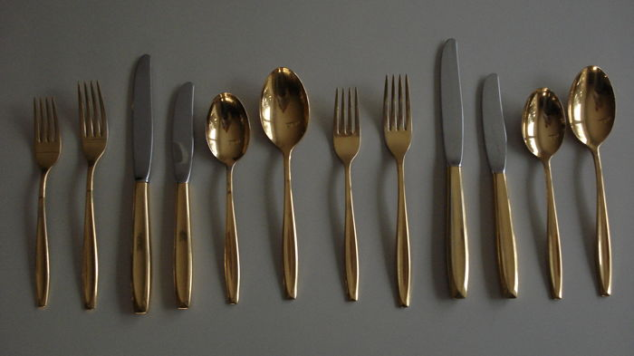 12 silver gilt table utensils by Christofle