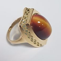 Reversible 18 kt Gold ring with Tiger's eye and Chrysocolla stones.