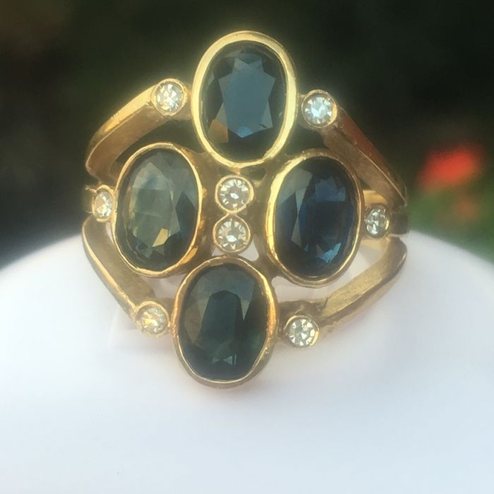 Antique ring with 4 blue natural sapphires and 8 diamonds