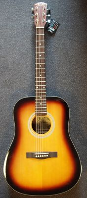 New Dreadnought by Fender with strap, tuning whistle, picks and an extra set of strings
