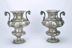 A pair of large embossed silvered bronze vases - XVIII century
