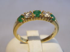 18 kt gold ring with natural emeralds 0.30 ct and two diamonds 0.22 ct.