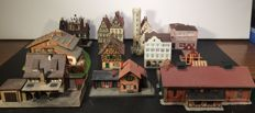 Vollmer/Kibri/and other N - Castle, half-timbered houses, blacksmith, burned-down house, hotel, engine shed, station, town houses and houses under construction.