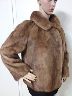 Blonde mink fur. Women's jacket / bolero