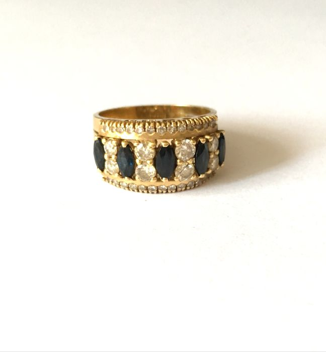 18 kt gold ring with diamonds and natural sapphires