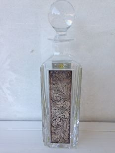 Crystal and silver bottle with a stopper