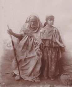 Unknown - A beggar and his daughter -.