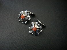 Art Deco silver hammered cufflinks set with a red coral