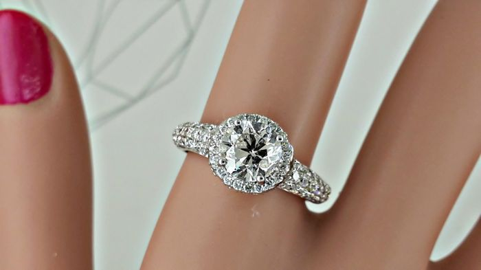 2.42 ct E/SI1 round diamond ring in 14 kt white gold - size 7