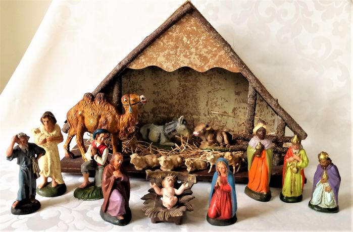 Old wooden nativity scene with 17 paper maché figurines