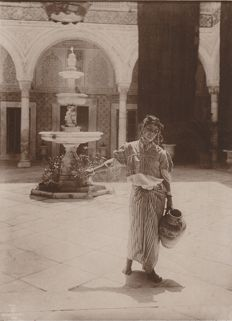 Lehnert and Landrock (act 1904-1914) - Young Tunisian girl in the patio of a House.