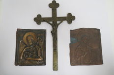 "Two ancient chased icons of beggars and holy fools: ""God the parent"" and ""Holy Mary"". The exact age is not known. As a gift, a bronze Orthodox cross, the beginning of the mid-20th century."