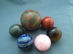 A collection of mineral spheres - 5 to 8.1 cm - 1728 gm (6)