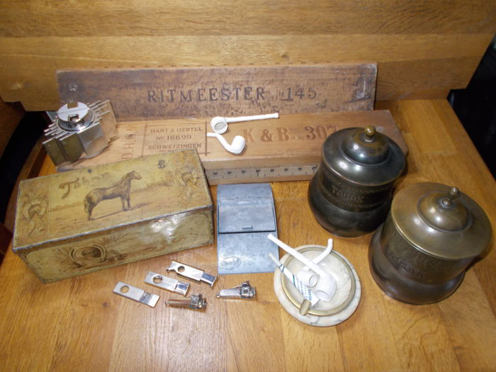 Tabor cigar can, tobacco jars, ashtrays, cigar cutters, lighter, cigar planks, porcelain pipes, last century.""