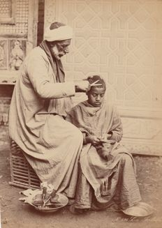 C. & G. Zangaki (active 1870-1880) - Ambulant barber in the streets of Cairo, Egypt
