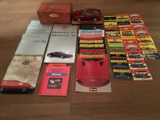 Bburago Ferrari 456 GT Bordeaux red with, 9 Bburago catalogues (A4-format), 9 Bburago newsletters (A4-format) , Bburago model car book and 25 pocket catalogues