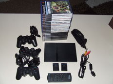 Sony Playstation 2, 3 controllers, 2 memorycards, remote controller and 19 games