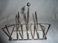 Silver plated toast rack in the manner of Christopher Dresser