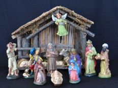 Old wooden nativity scene with 16 paper maché figurines
