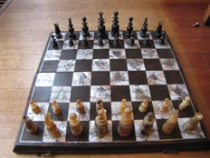 Horn-carved chess game, wooden board inlaid with mother-of-pearl scenes