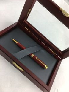 Aurora ballpoint pen red with GT accents in luxury wooden box.  NOS