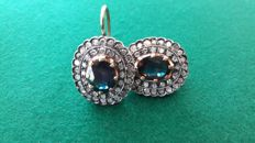 Vintage gold earrings with diamonds and natural sapphire in the centre