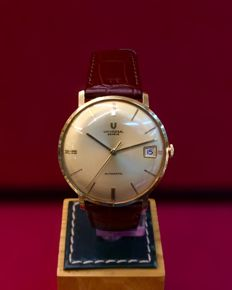 Universal Genève - Microtor Date. Oro 18 kt. Automático. - Heren - 1970-1979