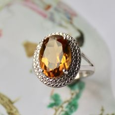 Ring of Sterling silver with oval faceted champagne color large Quarts. Excellent state.