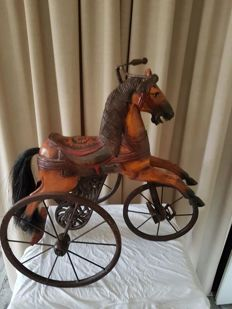Beautiful large decorative wooden tricycle with a wrought iron base