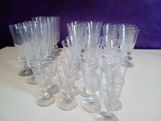 36 crystal glasses of various sizes