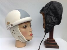 Brown leather driver's hat and old motorcycle helmet - ca. 1950