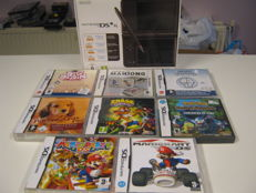 Boxed DSI xl including charger and 8 games like: Mario party + Mario Kart + Pokemon mystery dungeon and more