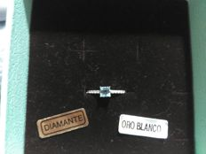 18 kt white gold ring, with sky blue ropaz and 14 diamonds H-SI1