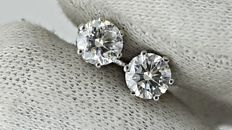 1.34 ct  SI1  round diamond stud earrings 14 kt white gold