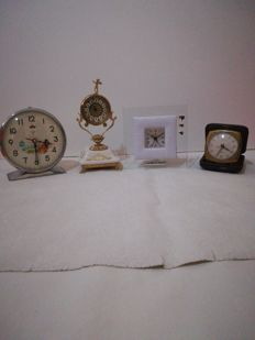 Four fantastic clocks of different times - Debora Carlucci & Blessing & Veglia & Shanghai