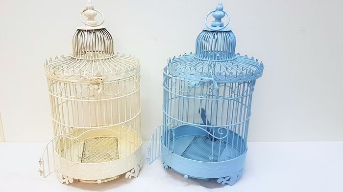 Two vintage and decorative bird-cages