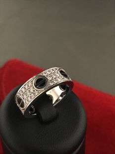 Cartier love ring, diamond, ceramic.