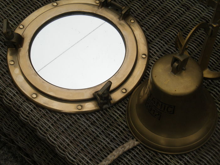 Porthole mirror and ship bell. (replica)