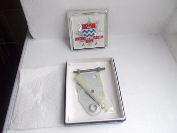 vintage LONDON FIRE BRIGADE chrome car badge with fixings unused still in box