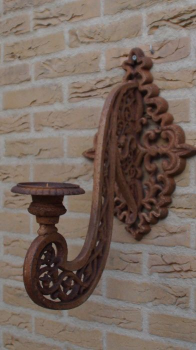 Large cast iron wall sconce for outdoor use
