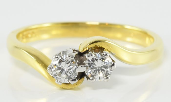 0.42 ct twin diamond ring in 18 kt gold ** no reserve **