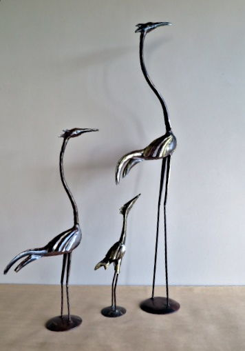 Three bronzed metal herons - partly gilded