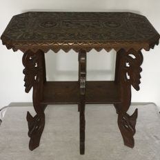 Table with a lot of carvings (elephant, flowers & leaves) - Indonesia - late 20th century (h 67 cm)