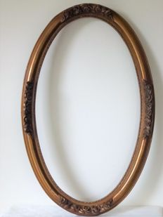 Large (80 x 50 cm) antique wooden gold-plated oval frame with ornaments of roses, France, ca. 1920