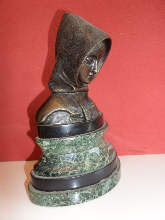 Bronze bust of a woman with cap on a marble pedestal - early 20th century