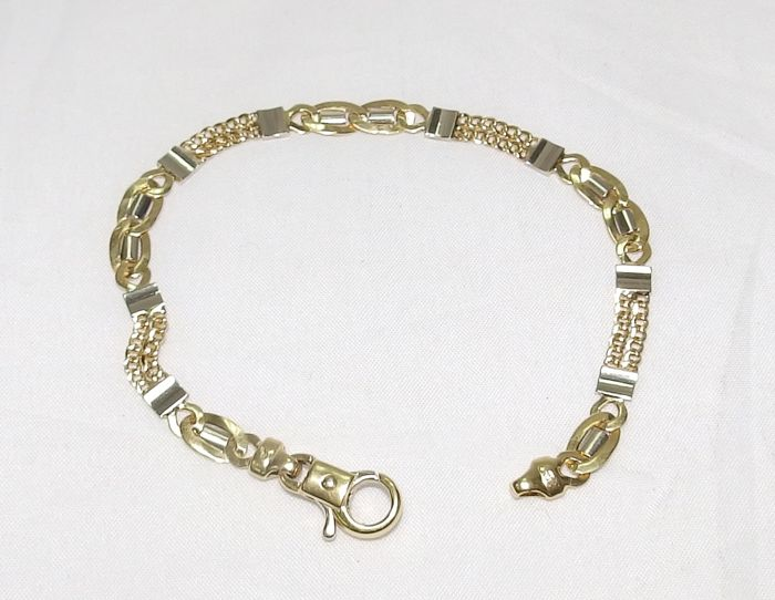 Curb chain bracelet in two-tone 18 kt gold Length: 19.5 cm