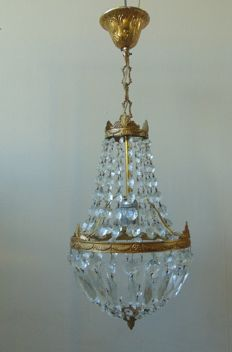 A chandelier and two wall lights, late 20th century