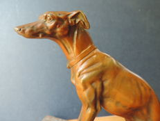 Whippet dog on a marble base, bronze plated metal, origin France
